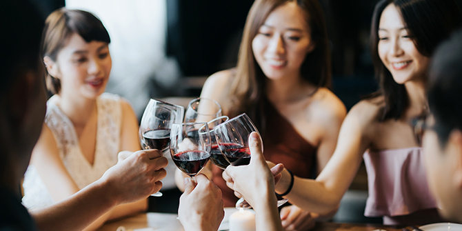 Photo of women toasting with wine glasses